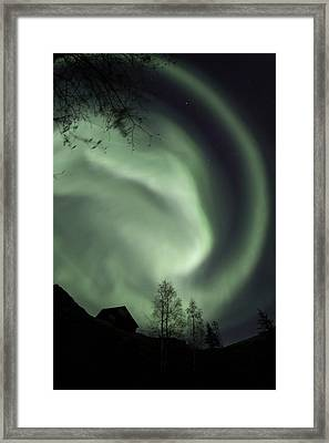 Swirling Aurora Borealis Fills The Framed Print by Dave Brosha
