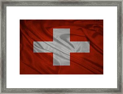 Swiss Flag Waving On Aged Canvas Framed Print by Eti Reid