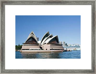 Sydney Opera House And Large Cruise Liner Framed Print by Ashley Cooper