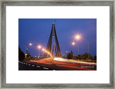 Sydney Traffic And Anzac Bridge At Twilight Framed Print by Colin and Linda McKie