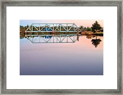 Symmetry On The Black Water River Framed Print