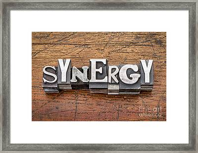 Synergy Word In Metal Type Framed Print by Marek Uliasz