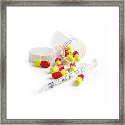Syringe And Capsules Framed Print by Science Photo Library
