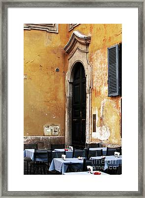 Table By The Wall Framed Print by John Rizzuto