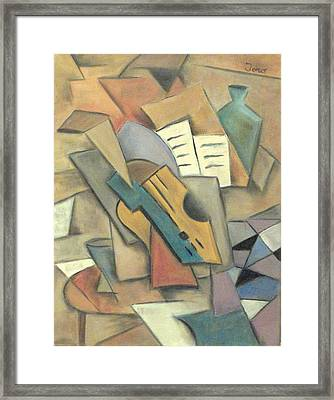 Table With Guitar Framed Print