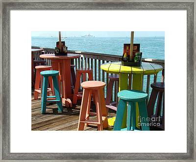 Tables With A View Framed Print by Eva Kato