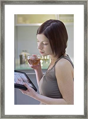 Tablet Computer Use Framed Print by Science Photo Library