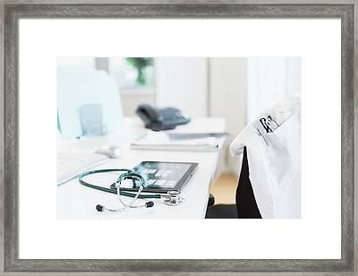 Tablet Pc In Doctors Office Framed Print by Tetra Images