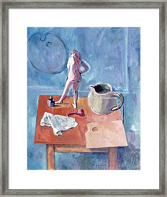 Tabletop With Figurine Framed Print by Mark Lunde