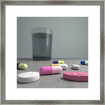 Tablets And Glass Of Water Framed Print by Robert Brook