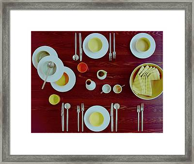 Tableware Set On A Wooden Table Framed Print by Romulo Yanes