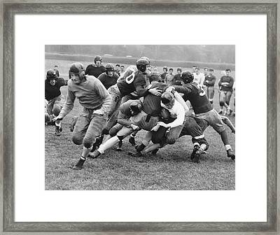 Tackled In The Football Line Framed Print by Underwood Archives