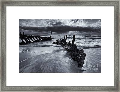 Taken By The Sea Framed Print by Mike  Dawson