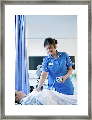 Taking A Patient's Temperature Framed Print by Lth Nhs Trust