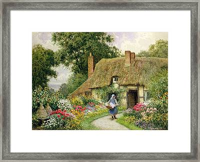 Taking Out The Washing Framed Print by Arthur Claude Strachan