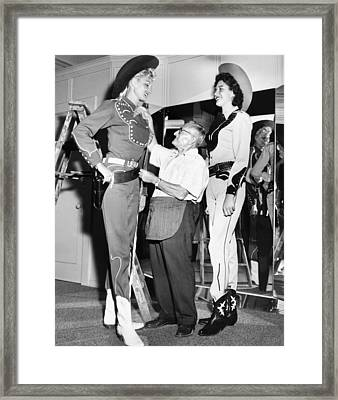 Tall Cowgirls Get Fitted Framed Print by Underwood Archives