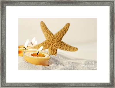 Framed Print featuring the photograph Tea Light Candles In Sand With Star Fish by Sandra Cunningham