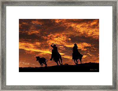 Team Roping At Sunset Framed Print by Stephanie Laird