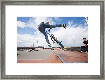 Teenage Boys Perform Aerial Stunts Framed Print