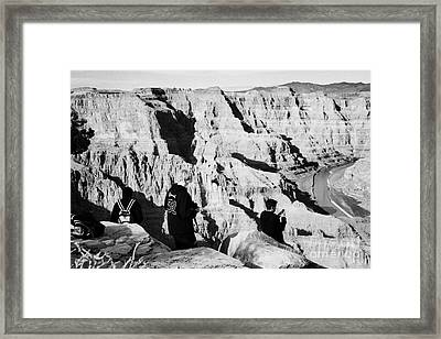 teenage boys standing looking into the grand canyon and colorado river guano point Grand Canyon west Framed Print