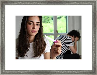 Teenage Couple With A Pregnancy Test Framed Print