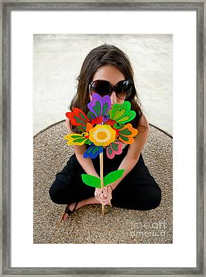 Teenage Girl Hiding Behind Toy Flower Framed Print