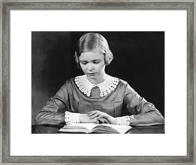 Teenage Girl Reading A Book Framed Print by Underwood Archives