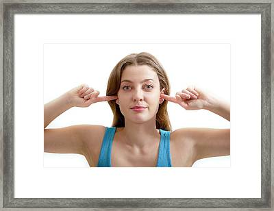 Teenage Girl With Fingers In Ears Framed Print by Lea Paterson