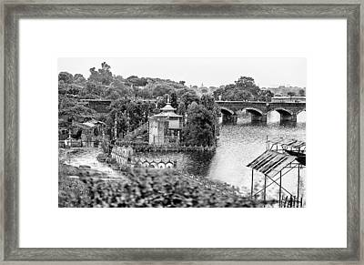 Temple By The River Framed Print by John Hoey