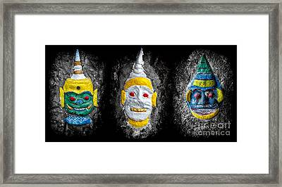 Temple Faces Framed Print by Adrian Evans
