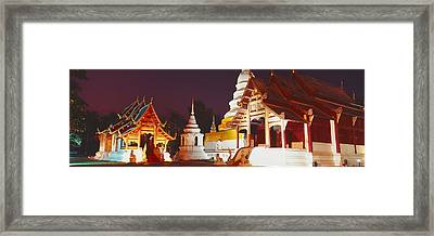 Temple Lit Up At Night, Wat Phra Singh Framed Print by Panoramic Images