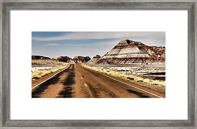 Tepees Among The Road Framed Print