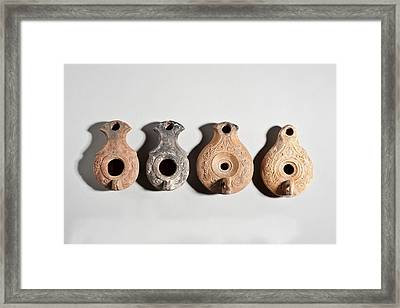 Terracotta Oil Lamps Framed Print
