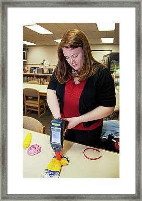 Testing For Lead In Children's Toys Framed Print by Jim West