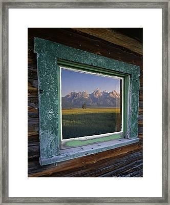 Teton Window Reflection Framed Print by Mike Norton