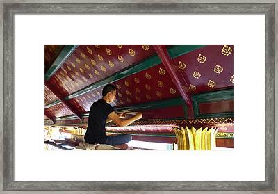 Thai Artisan At Work Framed Print