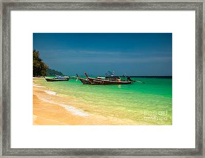 Thai Longboats Framed Print by Adrian Evans