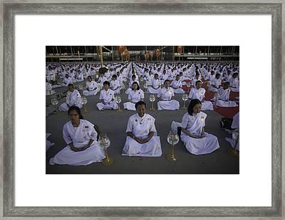 Thai Women Pray For Peace Framed Print by David Longstreath