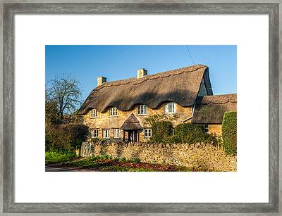 Thatched Cottage In Kingham Oxfordshire Framed Print by David Ross