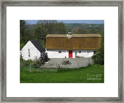 Thatched Cottage Framed Print