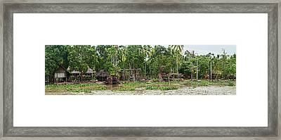 Thatched Roof Houses On The Bank Framed Print by Panoramic Images