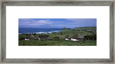 Thatched Roofed Rondawel Huts Framed Print by Panoramic Images