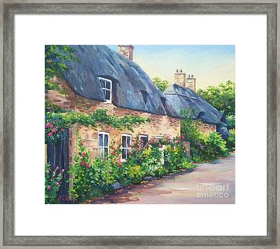 Thatched Roofs Framed Print by John Clark