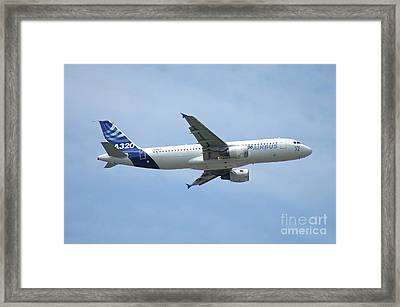 The Airbus A320 In Flight Over Paris Framed Print by Riccardo Niccoli