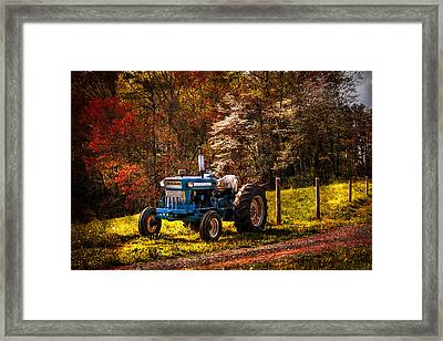 The Autumn Blues Framed Print by Debra and Dave Vanderlaan