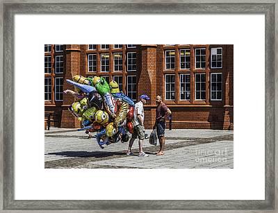 The Balloon Seller Framed Print