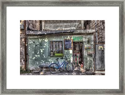 The Barber Shop Framed Print