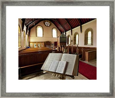 The Bible Open On A Stand At The Back Framed Print by John Short