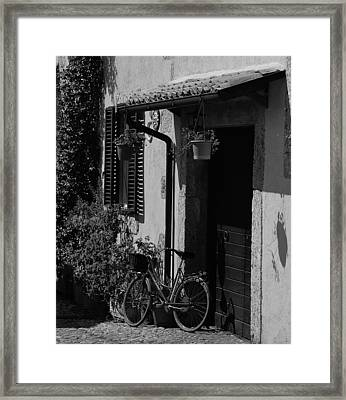 The Bicycle Under The Porch Framed Print by Dany Lison