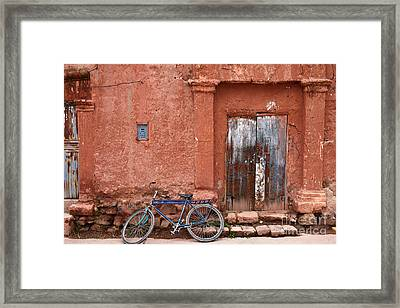 The Blue Bicycle Framed Print by James Brunker